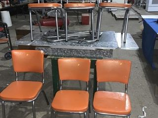 A vintage chrome table and six chrome chairs -