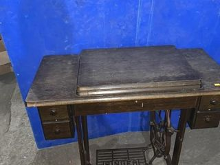 Singer treadle sewing machine believed to have