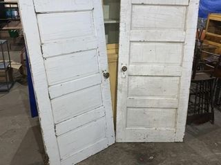 A pair of 30 inch vintage doors one is 76 1/2