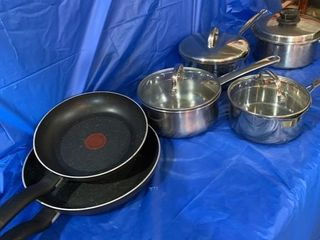 Several pots and a couple frying pans