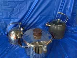 A pair of kettles and a pressure cooker
