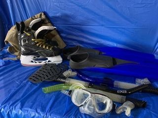 Pair of kids skates, swimming fins and snorkel?s