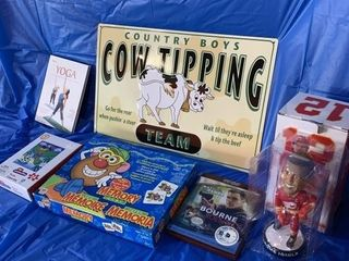 Calf tipping sign, yoga CD, memory game, Bourne