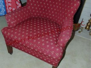 red cloth side chair on wheels