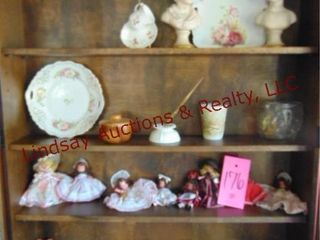 Approx 24 pcs of decor  13 dolls  plates