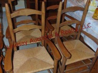 4 wood chairs w  wicker seats  nice