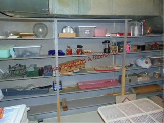 Contents on shelf  curtain rods  t squares  bins