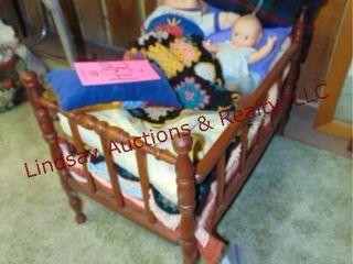 Small crib w  blankets  dolls   other
