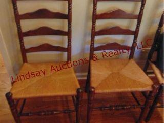 2 wood chairs w  wicker style seats