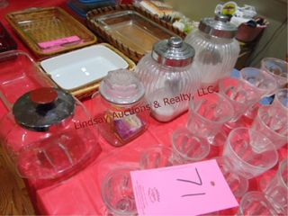4 glass cannisters  3 w  metal lids
