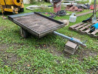 Wood flatbed garden trailer. Inspect for deta...