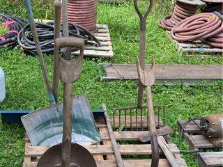 Vintage farm tools, shovels, axes, rake, and ...