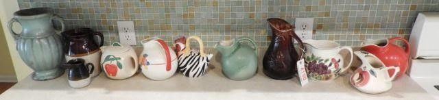 Lot # 4190 - (10) Pitchers by Hall, Watt, Pottery