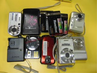 Approx 12 pcs various camers   1 charger  HP