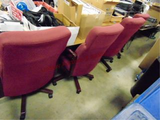 4 maroon office chairs on wheels