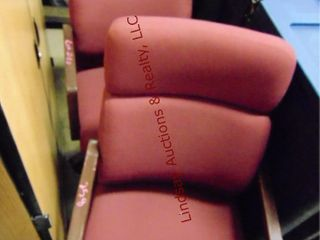 2 maroon office chairs on wheels