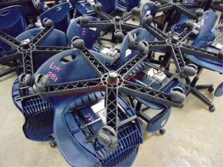 8 plastic blue rolling chairs