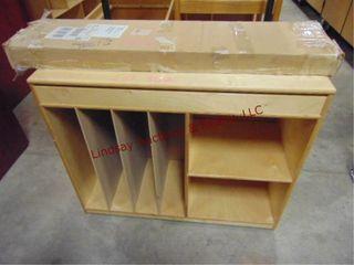 1 box of yard sticks   wood sorter  cubby cabinet