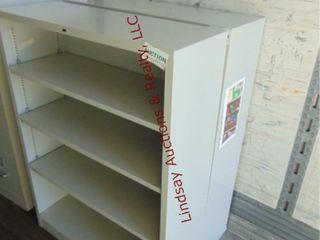 2 metal bookcases 34 5  x 12 5  x 47