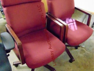 2 maroon rolling office chairs