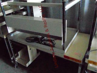 2 rolling metal computer workstations 36x24x51