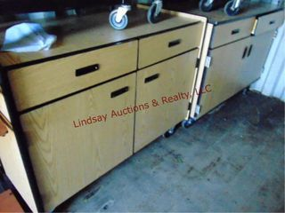 2 wood cabinets on wheels w  2 doors   2 drawers