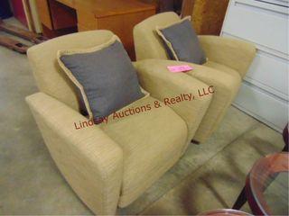 2 tan cloth side chairs w  pillows 34 x 32