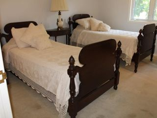 Walnut His and Hers single beds, carved