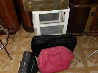 Plastic Storage Cart  Pink Duffle Bag  Brown Duffle Bag  2 Black Carrying Cases    A Green Box Case