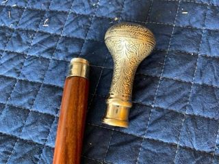 Neat Cane With Door Knob Style Handle location Storage