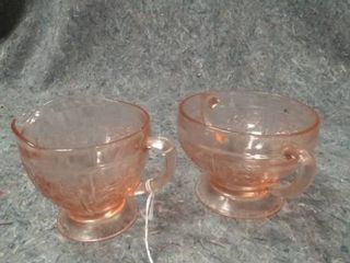 Pair of pink glass cream and sugar cups