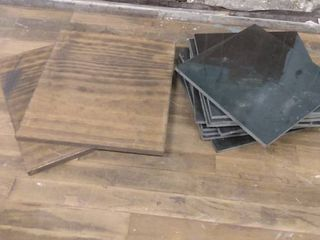 lot of floor tiles and decorative wooden boards