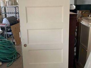 Wood interior paneled door