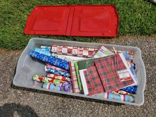 lot of Wrapping Paper with Rubbermaid Tub