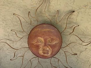 Wrought Iron Sun With Clay Face Wall Hanging location Right of Shelf 1