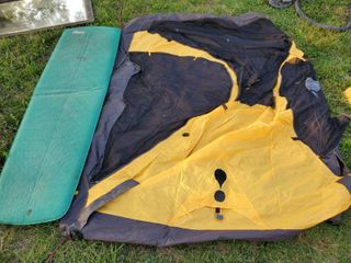 Single Yellow and Black Tent with Poles and Thermarest Mat