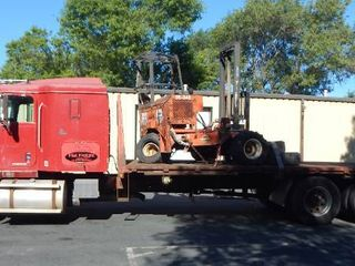 1998 International 9200 22 Foot Flatbed Semi Stretch 51,000 GVW Truck With Moffett M5000 Forklift