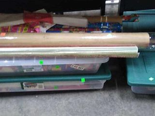 3 Plastic Bins Of Wrapping Paper
