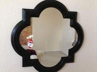 Fantastic shape framed mirror as photographed.
