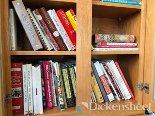 Lot of cookbooks, tv trays,