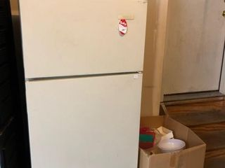 Refrigerator/freezer in garage along
