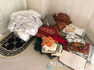 Assortment of linens in upstairs hallway as