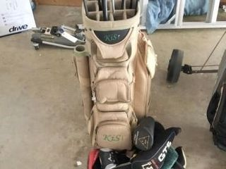Golf bag with assorted fairway woods and drivers