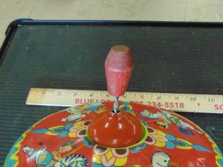 vintage metal spinning top toy