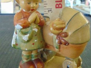Girl and baby carriage   hummel looking
