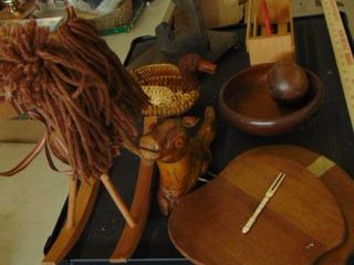 table full of wood items   rocking horse