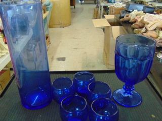 blue glassware and vase