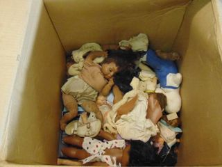 box of vintage baby dolls