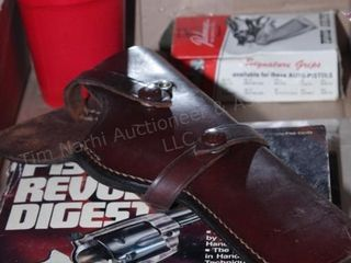 Brown leather holster, pistol digest, & pistol gri