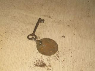 Brass Fob from China Doll Dodge City